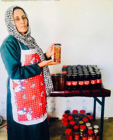 Zarlisht making her canned produce and the final product, Nangahar Province. Photo: Masooda Tokhi.