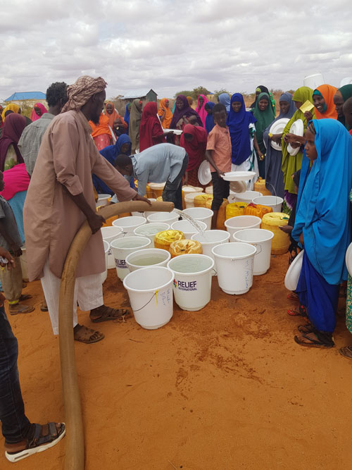 Water distribution in a drought-affected village in Somalia.