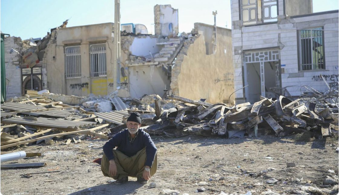 A man sits in front of the rubble of his former home, which was destroyed by a powerful 7.3 magnitude earthquake that struck along the Iran-Iraq border in late 2017. RI/RI Staff.