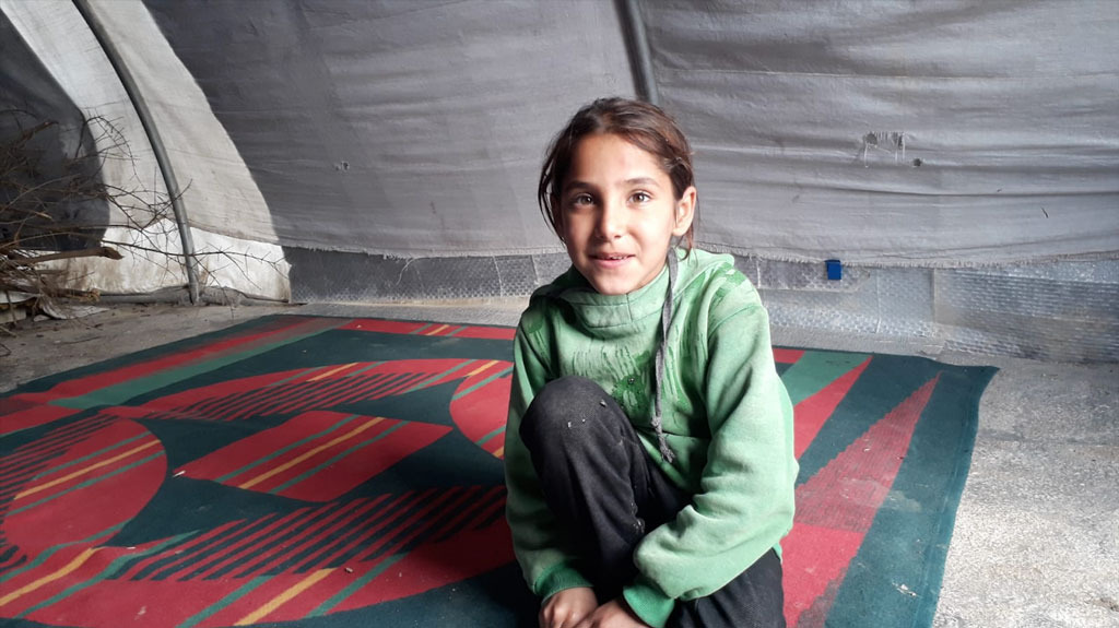 Five year old Miriam outside a camp for internally displaced people in Syria which is currently her home. RI