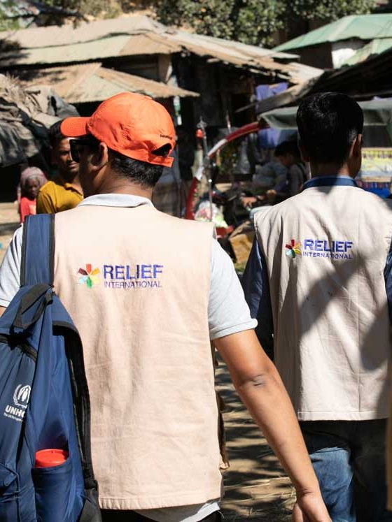 Teams walk through Bangladesh's crowded Kutupalong refugee camp to to reach remote areas of the camp. Rachel Elkind/RI