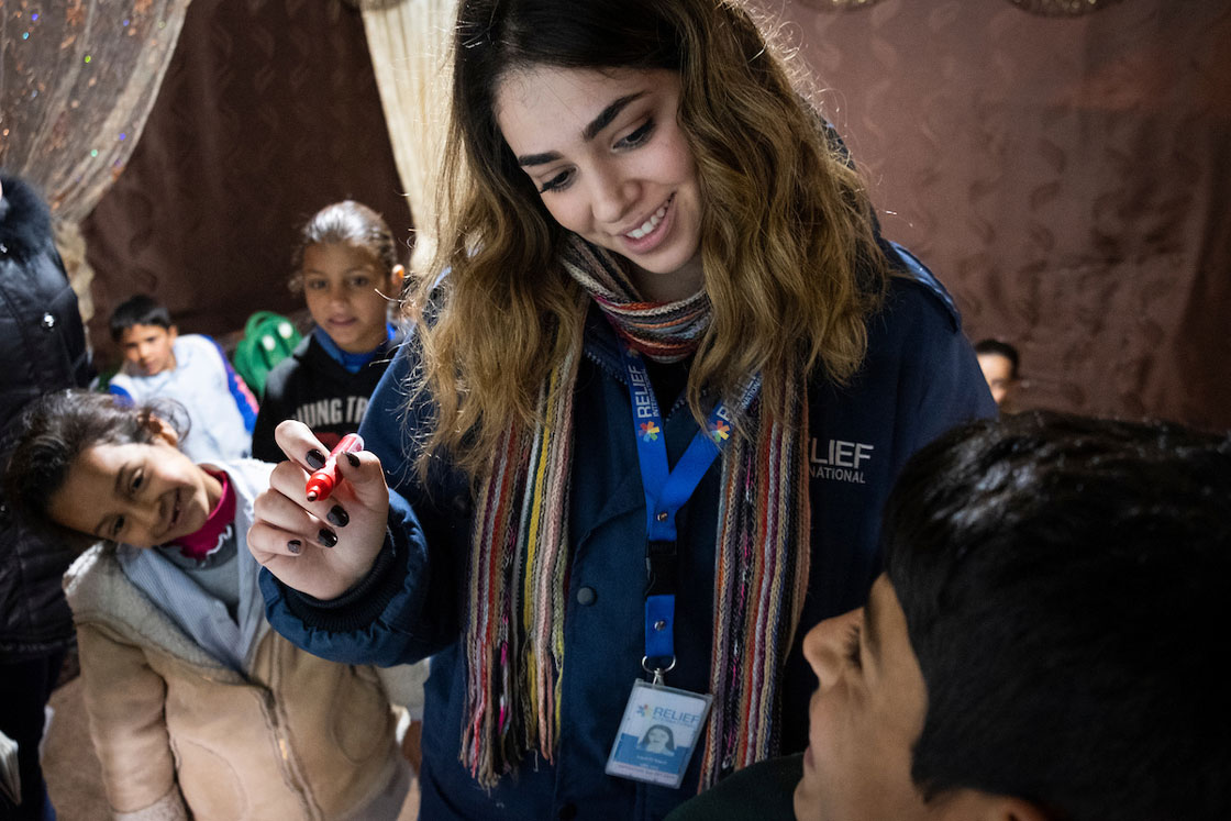 Relief International's Cash for Education Field Assistant Layal Al Sayed leads a homework support group once a week for two hours in an informal settlement of Syrian refugees in Lebanon's Bekaa Valley. Elie Gardner/RI