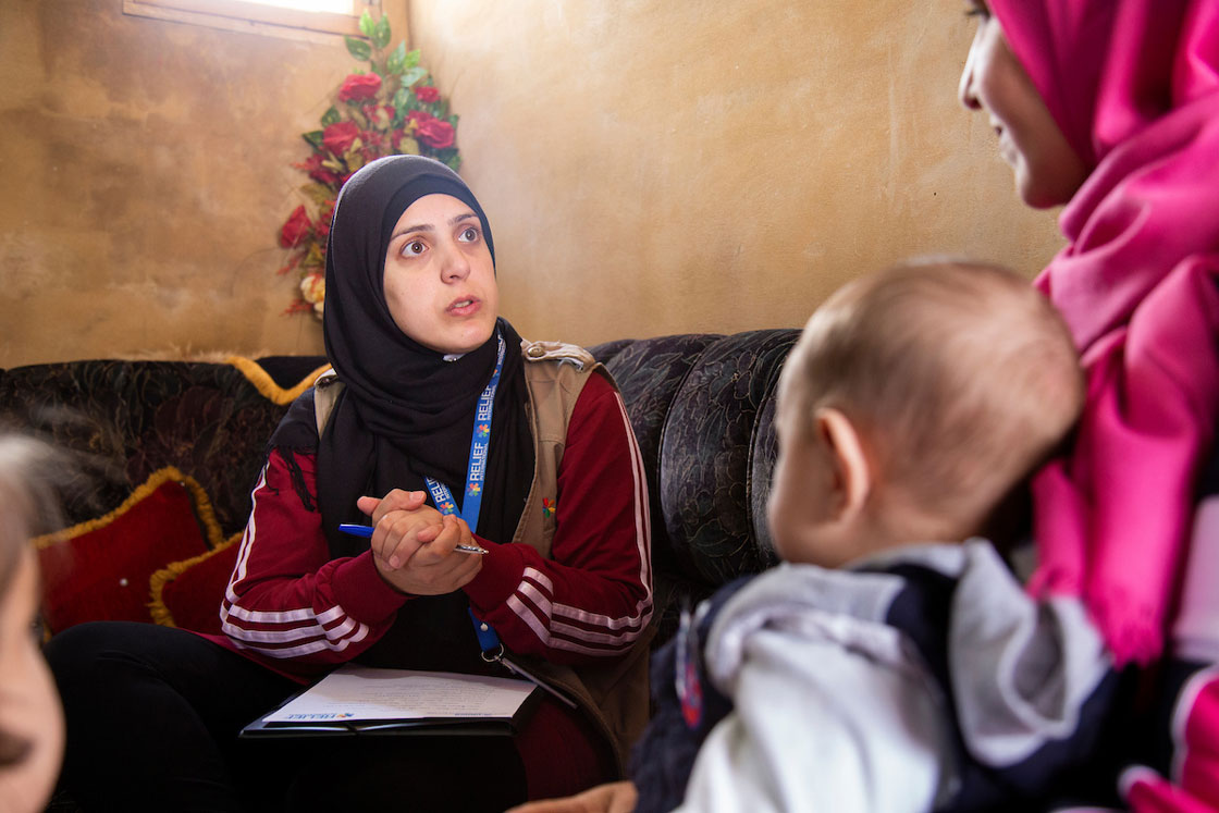 Relief International Social Worker Fatima Abdul Wahed hosts a one-on-one session with Aasma in her home. Elie Gardner/RI