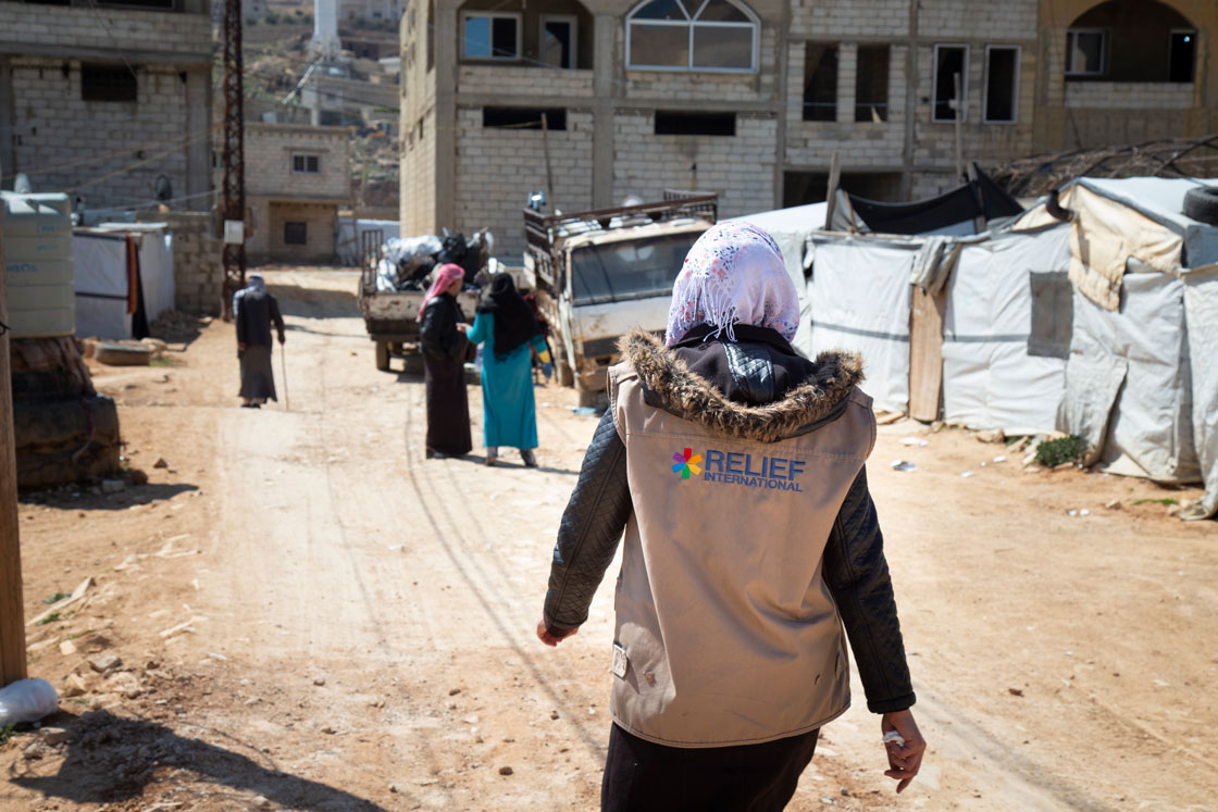 Iman walks through the informal tent settlement where she lives in Arsal, Lebanon. Elie Gardner/RI