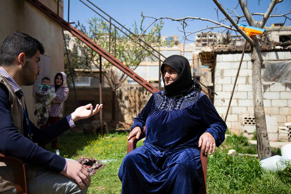 Relief International social worker Mazen Al Jabali talks with Mariam at her home in Arsal during a weekly counselling session. Elie Gardner
