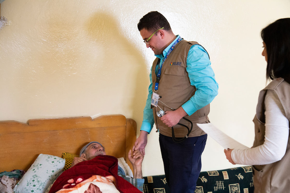 Relief International medical staff conduct a weekly checkup for a home-bound patient. Elie Gardner/RI