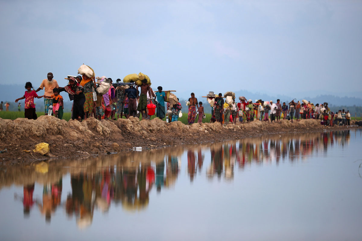 Rohingya refugees continue their way after crossing from Myanmar into Palang Khali, near Cox's Bazar in Bangladesh. Hannah McKay/Reuters