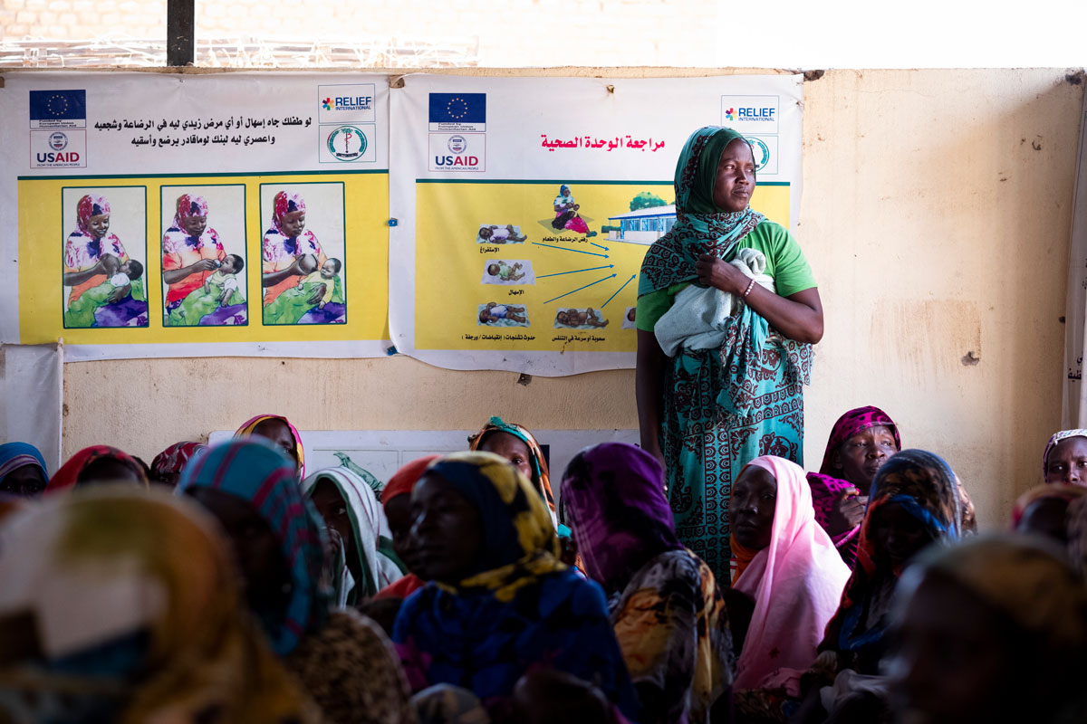 A woman attends a nutrition awareness session at one of Relief International's healthcare centers in Sudan's Zamzam camp. Elie Gardner/ RI