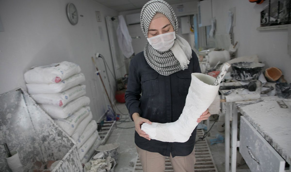 Rahaf is a technician who makes prosthetic limbs at Relief International's clinic. Rachel Elkind/RI