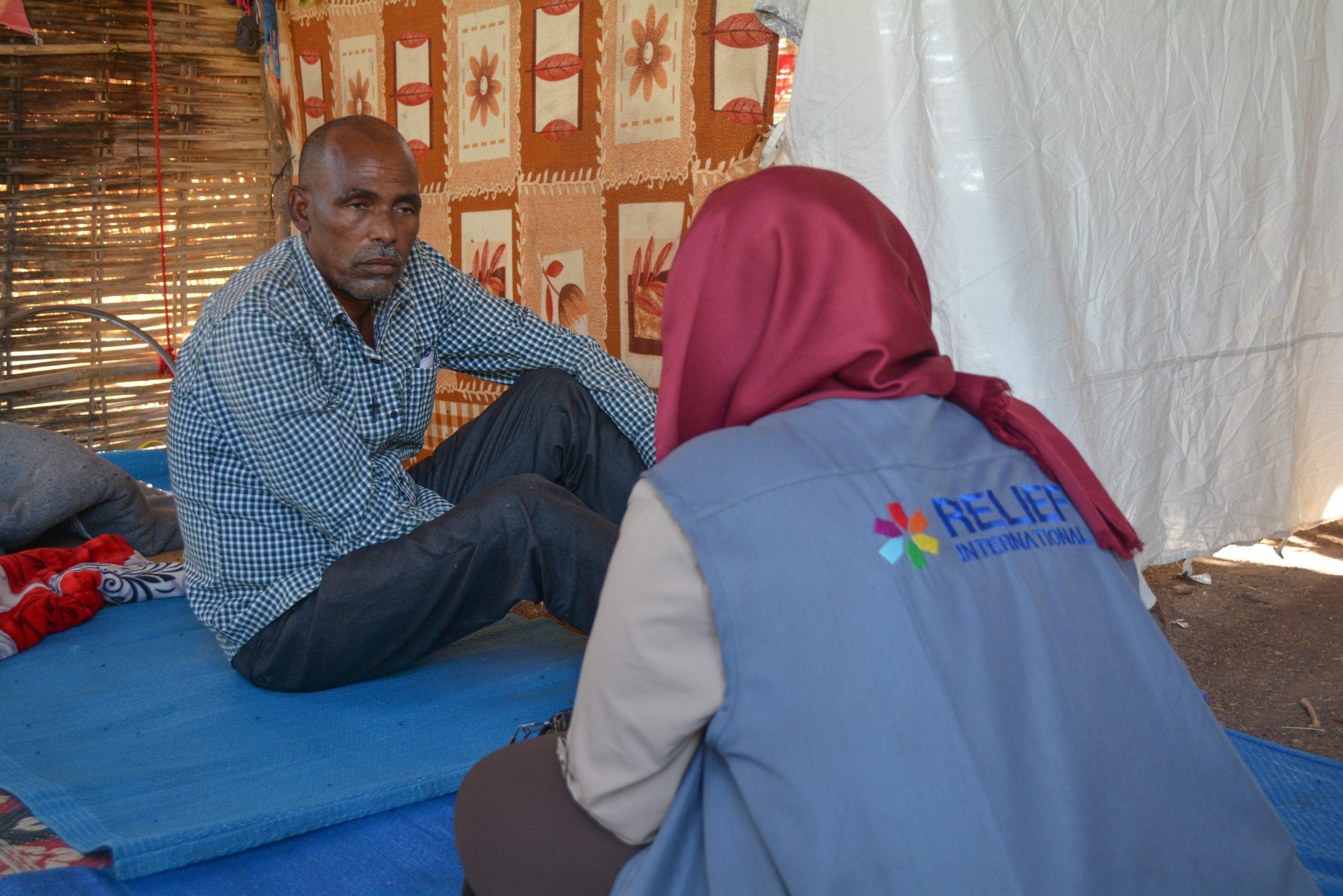 RI-Staff-Meeting-with-the-Refugee-Population-in-Um-Rakuba-scaled.jpg